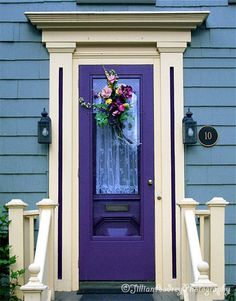 LOVE the purple door! Not so sure about the house color with it though.