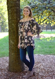This floral cold shoulder top is perfect for Fall! Pair with jeans and boots for the best look. Shop now at Hip Chics Boutique!