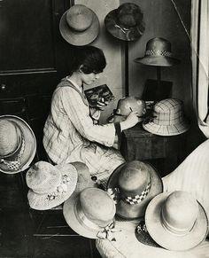 hat designer painting hats, kensington, england, 1919