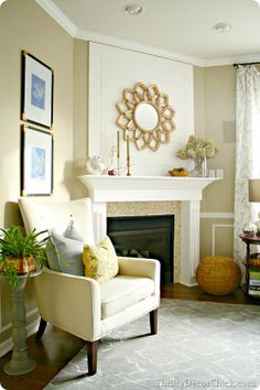 A starburst mirror over the fireplace from #homegoods