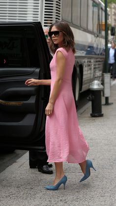The English designer, Victoria Beckham, brought a cheery twist to a tough silhouette, the midi dress.