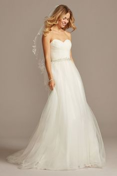 Imagine walking down the aisle in this stunning strapless tulle ball gown, complete with a sweetheart neckline and beautifully pleated bodice. Finish your look by adding special touches, like a bloomi Sweetheart Wedding Dress, Tulle Wedding, Bridal Wedding Dresses, Wedding Dress Styles, Peacock Wedding, Davids Bridal, Tulle Ball Gown, Ball Gowns, Wedding Dress Sleeves