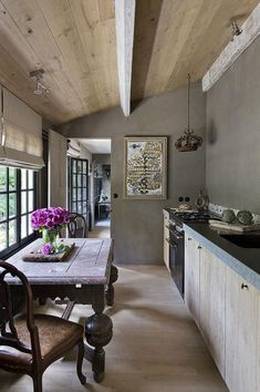 Franck Delmarcelle designed Belgian kitchen with rustic elegance.