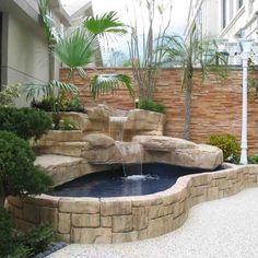 estanque de piedra con cascada