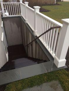 Basement walkdown, blustone cap, parged walls, with fence detail.. Nantucket