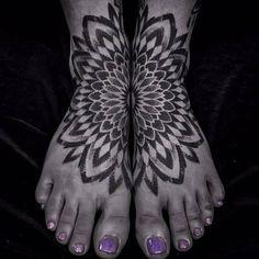 Matching mandala tattoo on both feet.
