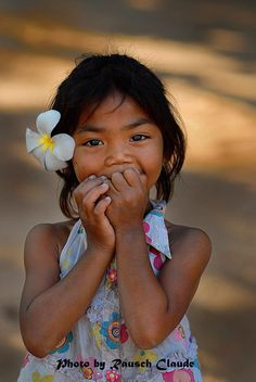 Cambodian little sunshine by Claude Rausch