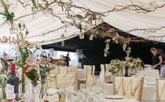 A Wilde Bunch Autumn marquee design at Chew Valley Lake. Featuring a long top table design, round table designs and an overhead matrix of contorted hazel with hanging bottles. Table Designs, Marquee Wedding, Long Tops, Canopy, Garland, Bottles, Wedding Flowers, Autumn, Table Decorations