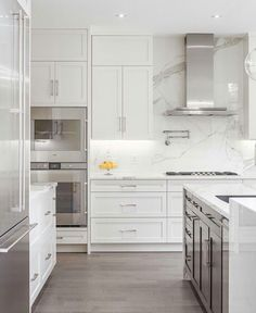 Color combo - white cabinets, grayish wood floor, marble looking counters