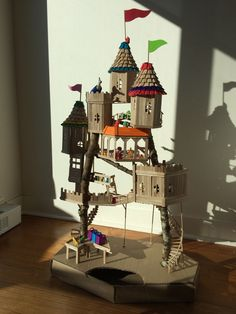 Popsicle stick castle made out of 980 sticks! Stands 3 1/2 feet tall and it took 35 hours to make. Rooves and sanding took the most time. My kids have played with it for hours!