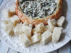 Ricotta Spinach Dip - Amanda's Cookin' - If you're looking for something a little different that your guests won't stop eating this NYE, try this tasty hot dip!