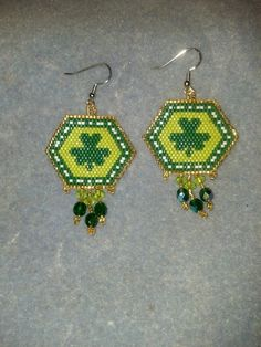 Shamrock surrounded by gold earrings
