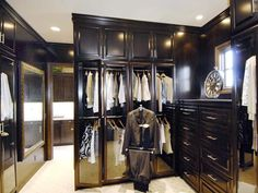 Mahogany Closet: A grand walk-in closet is demonstrated with an abundance of custom cabinetry, high-end materials and chic accents.  From HGTVRemodels.com