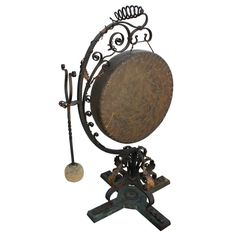 Extremely Decorative Dinner Gong.   Bronze. Not the run of the mill gong [I don't know if there is a run of the mill gong] . Yes, everyone should have one of these in their home.