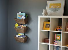 Smart Storage Idea - Hooks and woven baskets to hold books in the nursery or kids room!
