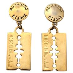 Moschino by Redwall 80s Gold Razor Blade Clip On Earrings. | From a unique collection of vintage clip-on earrings at https://www.1stdibs.com/jewelry/earrings/clip-on-earrings/