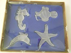 New Set of 4 Glass Ocean Sea Life Ornaments Seahorse Fish Dolphin Starfish Clear Frosted Glass Hanging Cord Included LSArts http://www.amazon.com/dp/B01AZQ252Y/ref=cm_sw_r_pi_dp_qD9Owb0JQG9C9