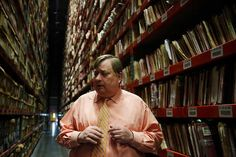 State Archivist Steve Excell stands in the stacks of overflow documents from the Washington State Archives that are now being stored at the active records building in Olympia, Wash.,