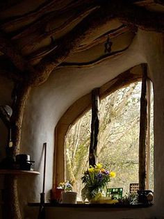 Cob house interior -- there could be chickens just on the other side of the window.