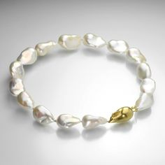 18k yellow gold bunny clasp with baroque white freshwater pearls hand-crafted by Gabriella Kiss. @quadrum