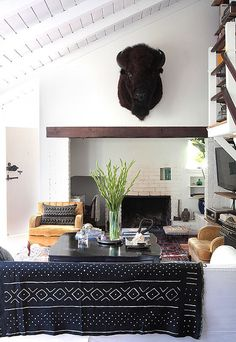 Mud cloth textiles and a mounted bison anchor the airy space. | This LA Cottage Makes a Case For White Walls | POPSUGAR Home