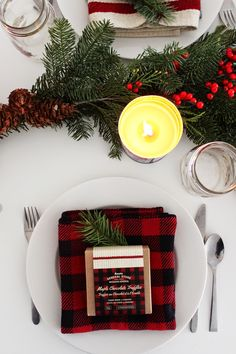 A winter holiday tablescape with evergreen boughs and berries (via Poppytalk).