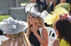 Looking lovely: A racegoer looks wonderful in monochrome dress and matching hat…
