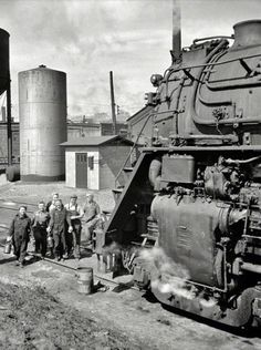 Great picture showing the size variation of people to a large steam locomotive