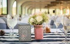 Loved these gorgeous centerpieces and table numbers! The navy and pink goes perfect together #LGShoreline 9.18.15
