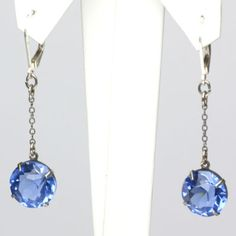 These sapphire-glass drop Art Deco earrings are well-made, versatile and easy to wear.