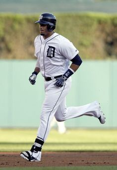 Victor Martinez rounds the bases after hitting a two-run home run in the first inning, 07/03/2014