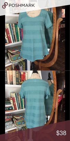 NWOT LuLaRoe small ruffle classic tee Removed tags, Never worn. Teal mint ruffled small classic tee. Soft and comfortable. Price is firm on this.   Please check out my other quality listings. All sales final. Will consider reasonable offers only. Cross posted.   Tags: rose animals carly maxi perfect tee tunics nicole pants cassie joy julia lindsay randy amelia azure sarah LuLaRoe Tops Tunics