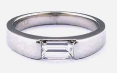 classic contemporary horizontally-set rectangular baguette diamond ring | I'm not usually one for baguette setting because they're usually over the top but this simple, flush design is gorgeous. | Designs by Indigo 2009