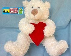 Talking White Hallmark bear holding red heart $15.00