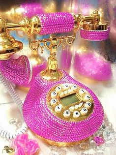 Find a vintage telephone at a thrift shop near you and make it look like a million bucks with some Swarovski Crystals!