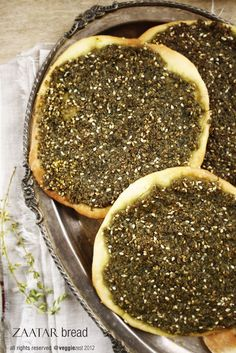 Za'atar Manakish or Zaatar Bread is a simple Arabic recipe – which is basically a kind of flat bread baked with Zaatar and olive oil spreadsrved with labneh Lebanese Cuisine, Lebanese Recipes, Middle East Food, Middle Eastern Recipes, Middle Eastern Bread, Veg Recipes, Bread Recipes, Cooking Recipes
