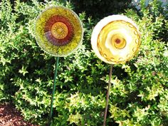 Fun!  Glass flowers for the garden.