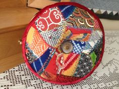 Crazy Quilt Pincushion with Japanese silks and velvet piping. 7-14
