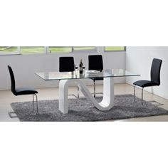 The Nero Dining Table Has A Serpent Shaped Base That Comes In White Lacquer Top