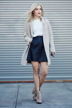 Love this open cardigan and leather mini skirt combo. Get this and more fall outfit ideas here. #falloutfits #outfitideas #cardigans #fallfashion
