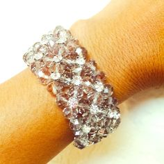 Crystal beads Bracelet Bought a couple of months go, but never used. This is so gorgeous. It can be used for an special occasion, or just to give a glamorous touch to your attires. Smoky and crystal clear color beads forming flower shapes. Center of flower are shinier. Jewelry Bracelets