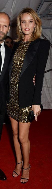 Rosie Huntington-Whiteley: Jackt – Balmain  Dress – Antonio Berardi  Purse – Christian Louboutin  Ring – Anita Ko