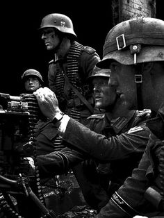 """CAVEAT: Though usually captioned """"a Waffen-SS MG42 crew of the Großdeutschland Division"""" or the like, this is actually a re-enactment photo, probably by Progetto 900 in Italy. The cartridge primers in the foreground are actually fired, indicating deactivation. The hi-res image quality, angle, setup, and fresh faces signal re-enactment."""