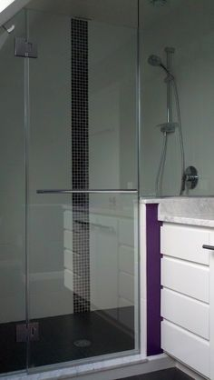 Master Bathroom renovation with clear glass frameless shower enclosure, granite countertops and separate make-up area using custom cabinets.