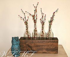With a little wood stain, and an eye for the creative, check out this wooden planter centerpiece
