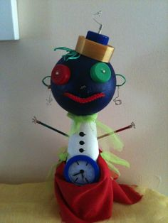 A Tim-Burton style Doll. Made from wool's cone and recycled materials!