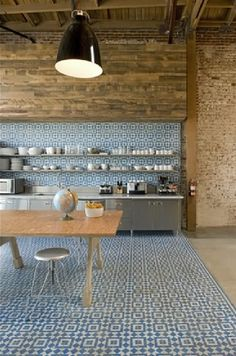 encaustic geometric tiles in kitchen - love the zoning