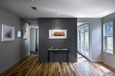 """Using cool charcoal as an accent in a lighter gray room is the perfect way to create a focal point. """"Light gray walls feel crisp and airy, while darker tones create a sultry, sexy, cozy mood,"""" she says."""