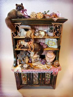 Good Sam Showcase of Miniatures. Hand painted cupboard and minis including two lovely Ragdoll cats from Bridget McCarty.