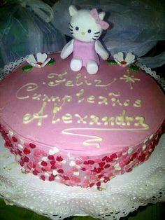 Torta hello kitty bañada en chocolate hecha por Mariana's Cake. https://m.facebook.com/marianas.cake.7